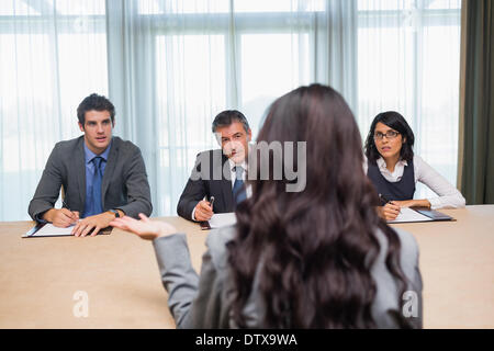 Woman being interviewed for new job - Stock Photo