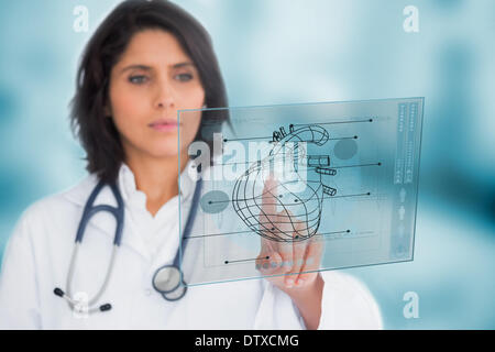 Cardiologist using a medical interface - Stock Photo