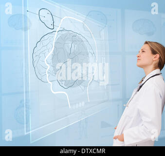 Woman doctor using a futuristic interface - Stock Photo