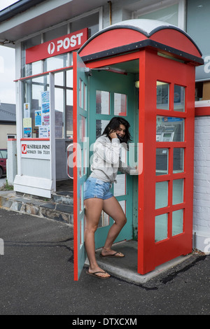 Old style red telephone booth, Stanley, Tasmania - Stock Photo