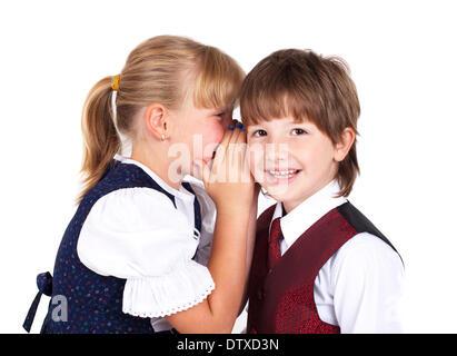 Two little kids telling secrets - Stock Photo