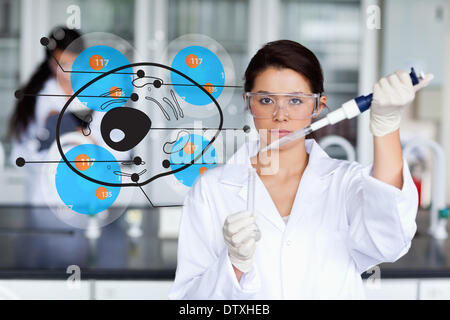 Serious chemist working with cell interface - Stock Photo