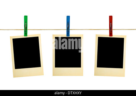 Retro photography on clothespins - Stock Photo