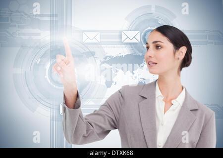 Businesswoman using futuristic interface - Stock Photo