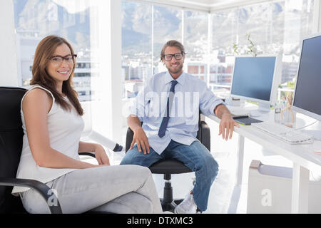 Pair of designers sitting in office - Stock Photo