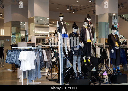 H&M mannequins on Display at Entrance in Oxford Circus - London UK - Stock Photo