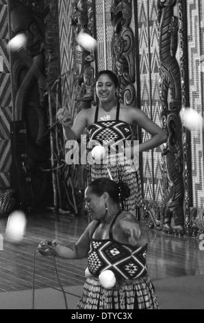 Maori people sing and dance during Waitangi Day in Waitangi, Northland, New Zealand (BW) - Stock Photo
