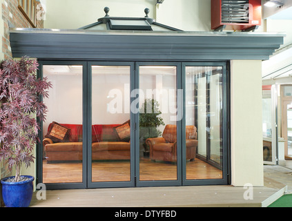A series of images showing folding doors and skylight on an ...