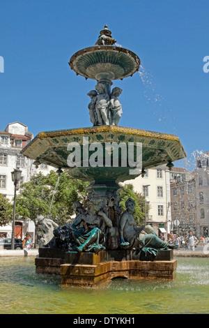 Bronze fountain on Rossio Square, in the city center of Lisbon, Baixa district, Portugal. - Stock Photo