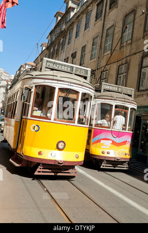 Famous yellow vintage streetcars or trams in Lisbon, Baixa district,  Portugal. - Stock Photo
