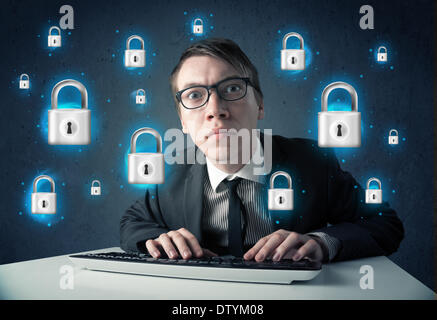 Young hacker with virtual lock symbols and icons - Stock Photo