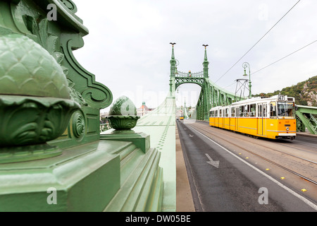 Liberty Bridge with tram, Budapest, Hungary - Stock Photo