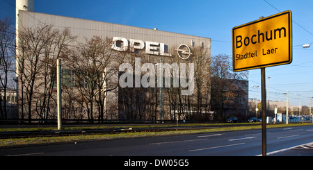Opel Works, a place-name sign in the foreground, Bochum, Ruhr area, North Rhine-Westphalia, Germany - Stock Photo