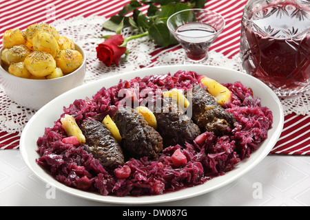 Beef roulade with red cabbage and roast potatoes - Stock Photo