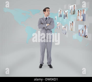 Businessman standing on map background - Stock Photo