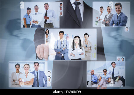 Businessman presenting pictures of coworkers - Stock Photo