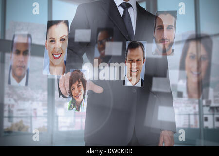 Classy businessman presenting profile pictures - Stock Photo