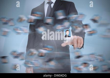 Businessman presenting profile picture - Stock Photo