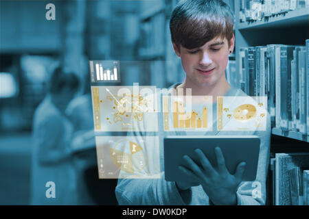 Young man studying on his digital tablet - Stock Photo