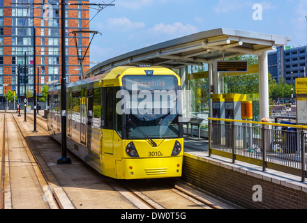 Metrolink light rail train at MediacityUK station, Salford Quays, Manchester, England, UK - Stock Photo