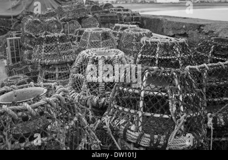 Stack of Lobster and crab pots stacked against Harbour wall in Paignton Harbour Devon UK - Stock Photo