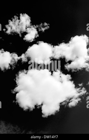 Black & white view of wispy white clouds against clear Colorado sky - Stock Photo