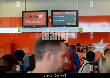 Passengers check-in at Jetstar Airways counter in New Zealand - Stock Photo