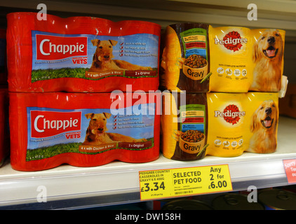 tins of dog food on shelf in a store - Stock Photo