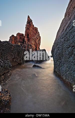 rock reef at sunrise - Stock Photo