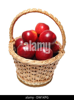 basket with red apples isolated on white - Stock Photo