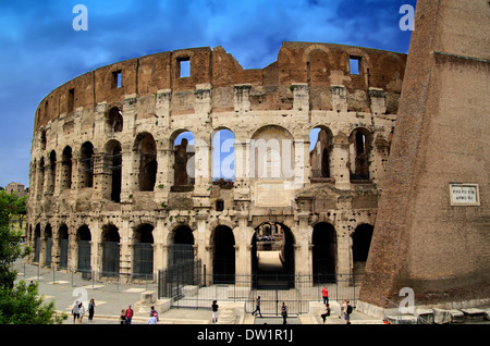 Famous Roman Colosseum (amphiteatre) in Rome in summer time - Stock Photo
