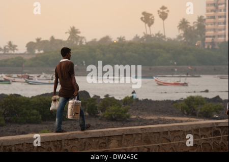 Tea man or Chi walla on the Bandstand promenade in  Bandra, Mumbai, India. - Stock Photo