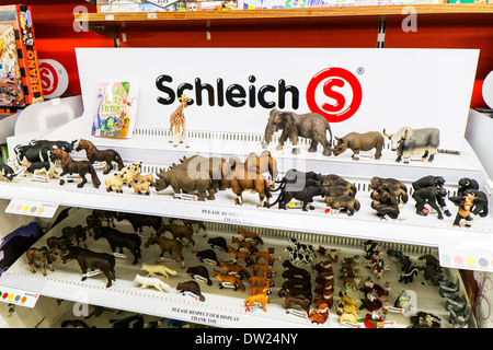 Schleich animals toy toys plastic figurines display stand shelf in shop - Stock Photo