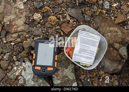Geocache and Satmap Active 12 GPS Unit. - Stock Photo