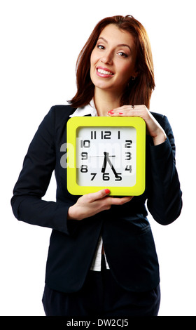 Smiling businesswoman holding wall clock isolated on white background - Stock Photo