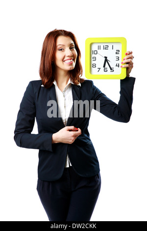 Happy businesswoman holding wall clock isolated on white background - Stock Photo