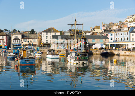 Brixham harbour Devon England with boats on a calm day with blue sky - Stock Photo
