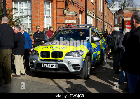 Hampton police station, Station Road, Hampton, Middlesex, UK. 26th February 2014.  Crowds gather in Station Road - Stock Photo