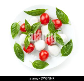 Caprese salad. Isolated on white background - Stock Photo