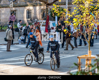 Municipal police officers patrol on bicycles Strasbourg Alsace France Europe - Stock Photo