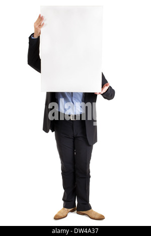 businessman holding up a blank white rectangular sign or placard with copyspace for your text in front of his face - Stock Photo