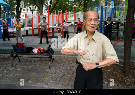 Chinese man practice Tai Chi in Seward Park in the newly trendy Lower East Side Chinatown neighborhood in NYC. WH - Stock Photo