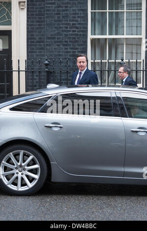 London, UK. 27th February 2014. 27th Feb 2014. British Prime Minister David Cameron sets off from Downing Street - Stock Photo