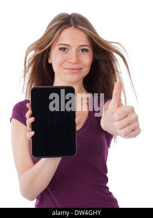 Young woman showing an electronic tablet and having a positive gesture - Stock Photo