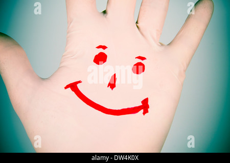 Smile drawn on a hand. - Stock Photo