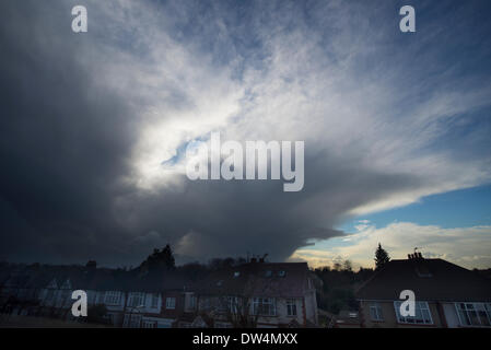 Wimbledon, South West London. 27th Feb, 2014. A massive cloud cell has been skirting London-Surrey borders this - Stock Photo