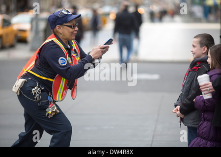 Manhattan New York city in North America, Pictured An MTA worker takes pictures for tourists - Stock Photo