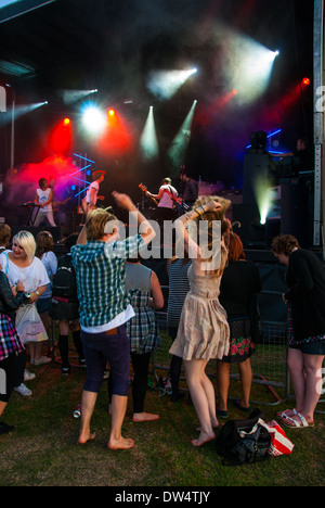 Teenagers at 'The Leefest concert',Beckenham. 'Saving Aimee' on stage. - Stock Photo