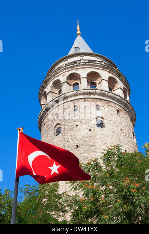Turkish flag in front of Galata Tower, Istanbul, Turkey - Stock Photo