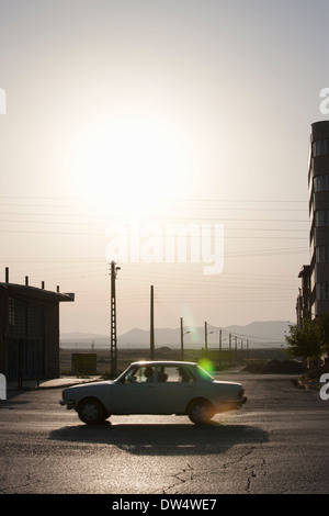 Car on main road sillhouetted, Bazargan, Maku County, West Azerbaijan District, Iran - Stock Photo